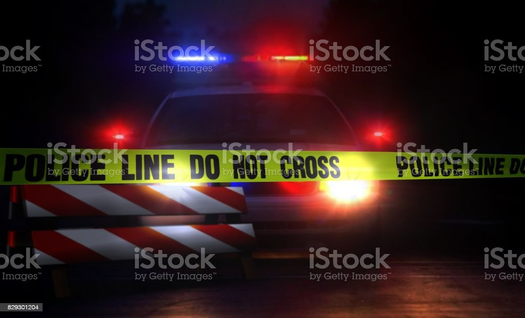 Police line do not cross at night stock photo