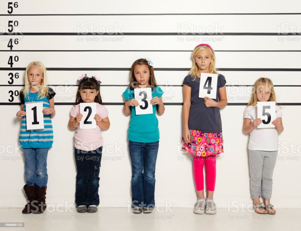 Police Line-Up of Five Little Girls royalty-free stock photo