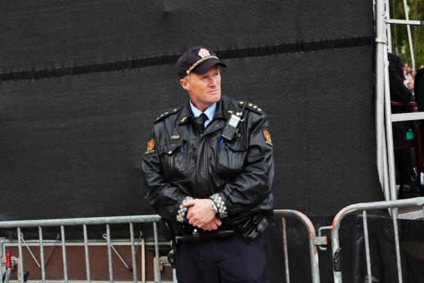 police man at work. - oslo city hall stockfoto's en -beelden