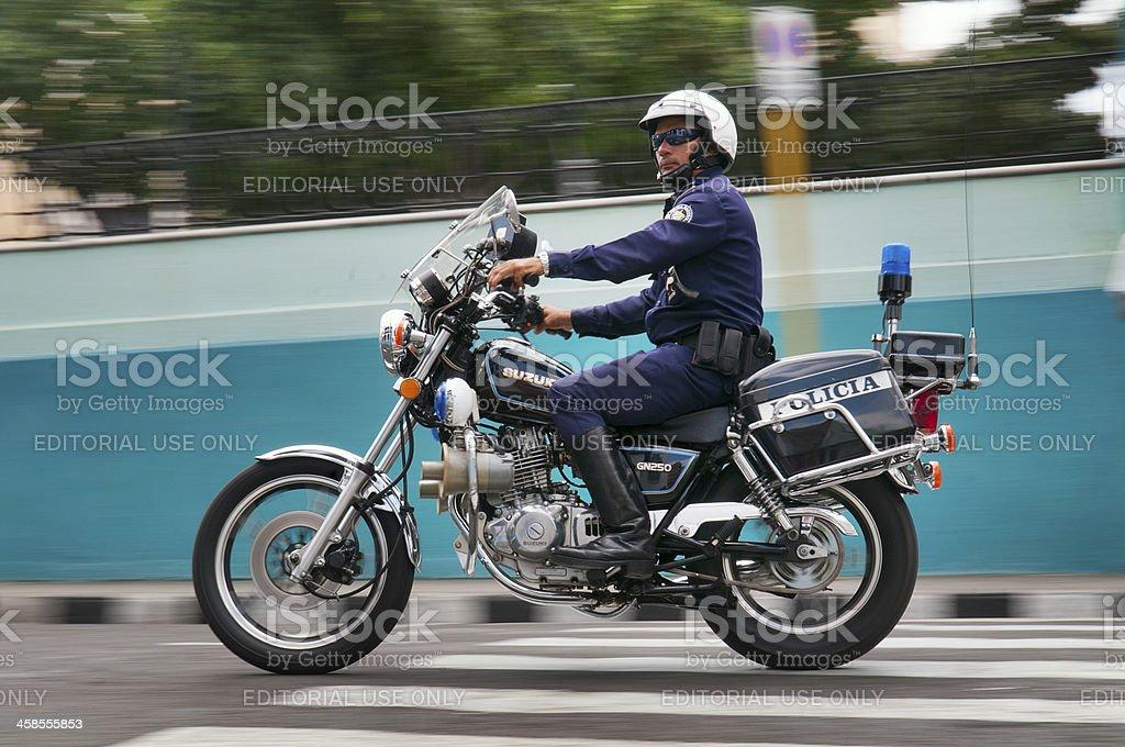 Police man riding motorbike, Santiago de Cuba royalty-free stock photo