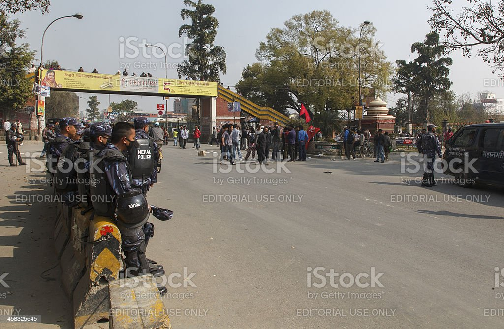 Police Maoist standoff during general strike royalty-free stock photo