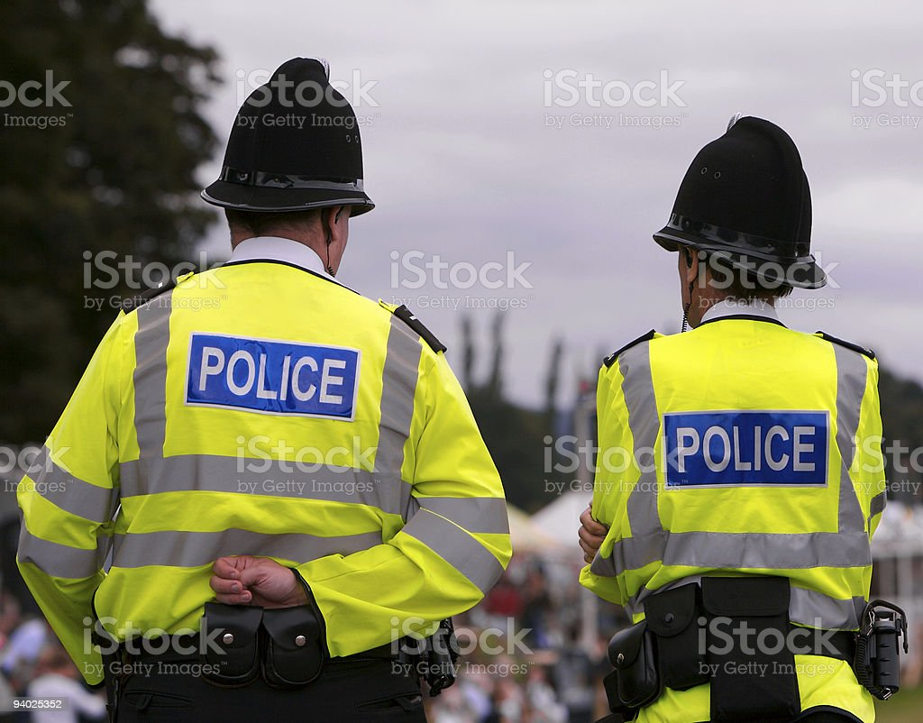 Police men at summer fair showground stock photo