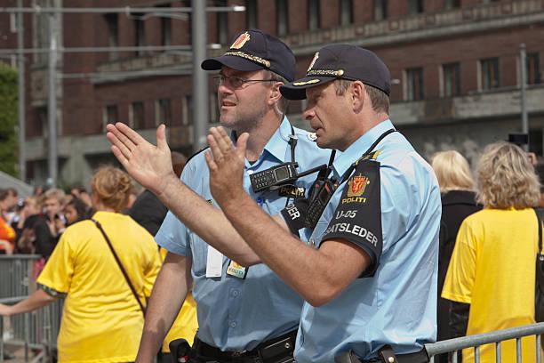 police men at work. - oslo city hall stockfoto's en -beelden