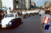 Berlin (West), Germany, 1963. Police motorcycle escort for a President. Also: spectators on the roadside, buildings and vehicles.