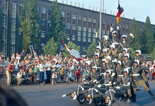 Berlin, Germany, 1974. The former West Berlin police motorcycle squadron at one of their famous artistic demonstrations in front of the berlin audience in the Masurenallee opposite the Rundfunkhaus Berlin.