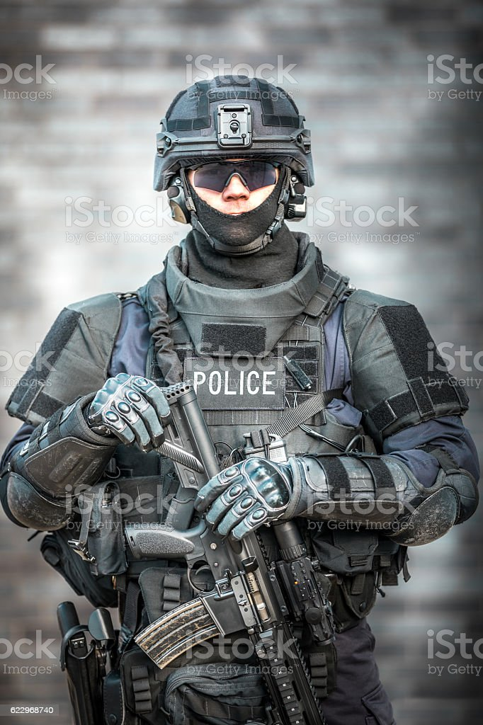 Swat Police Officer Against Brick Wall Stock Photo & More Pictures ...