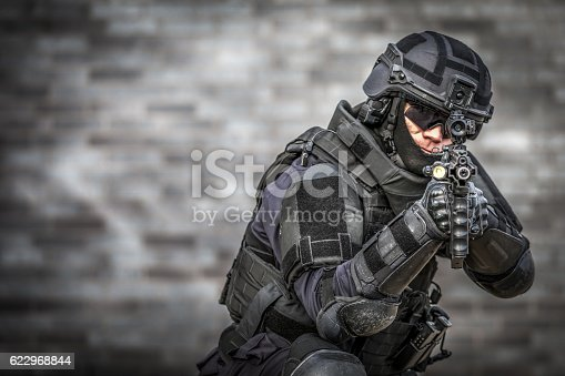 istock SWAT Police Officer Against Brick Wall 622968844