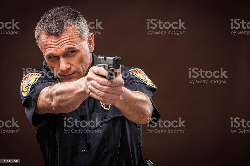 Police Officer Aiming Handgun stock photo