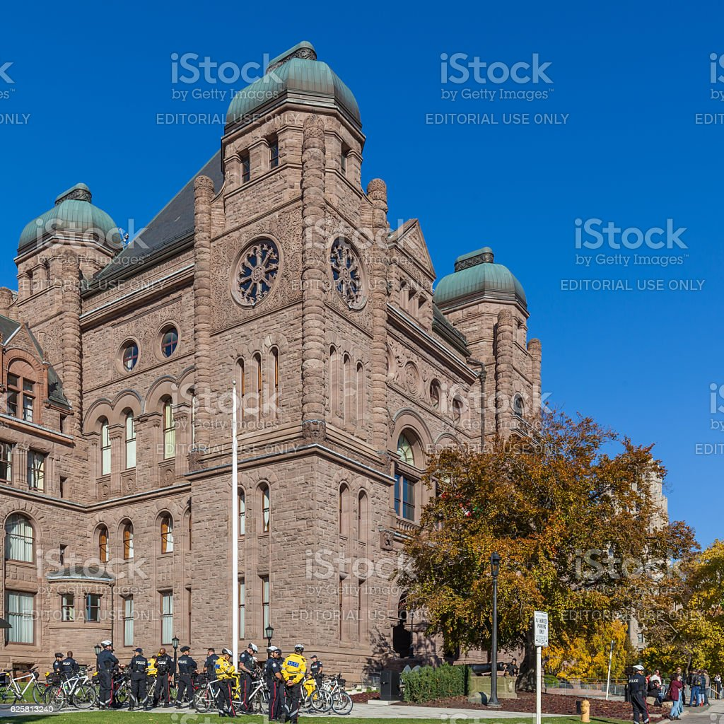 Police officer at Ontario Legislative Building at Queen's Park, Toronto. stock photo