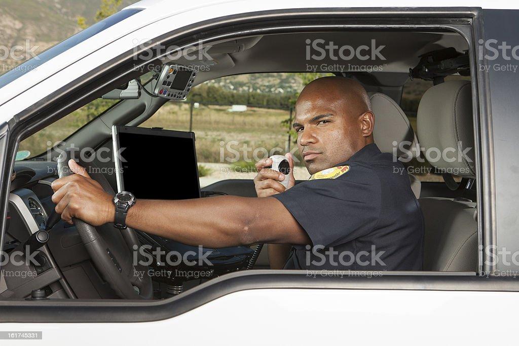 Police Officer calling in orders stock photo