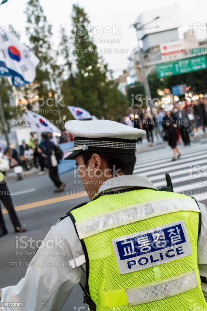 Police officer controls protest in Seoul, South Korea stock photo