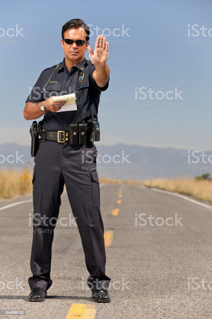 Police Officer gesturing Halt royalty-free stock photo