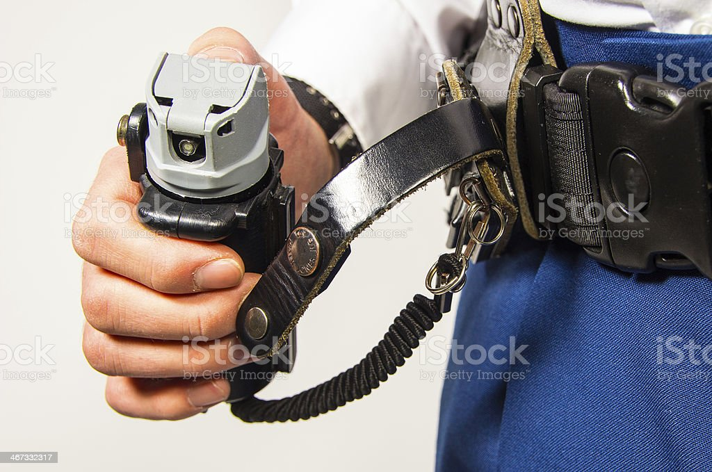 Police officer holding pepperspray stock photo