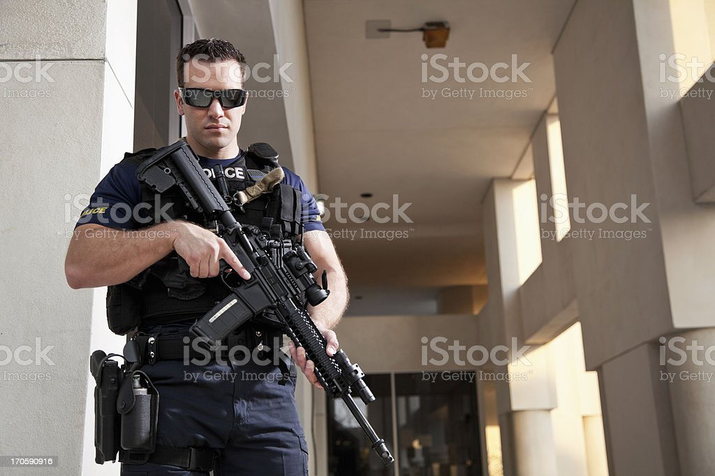 Police officer holding rifle stock photo