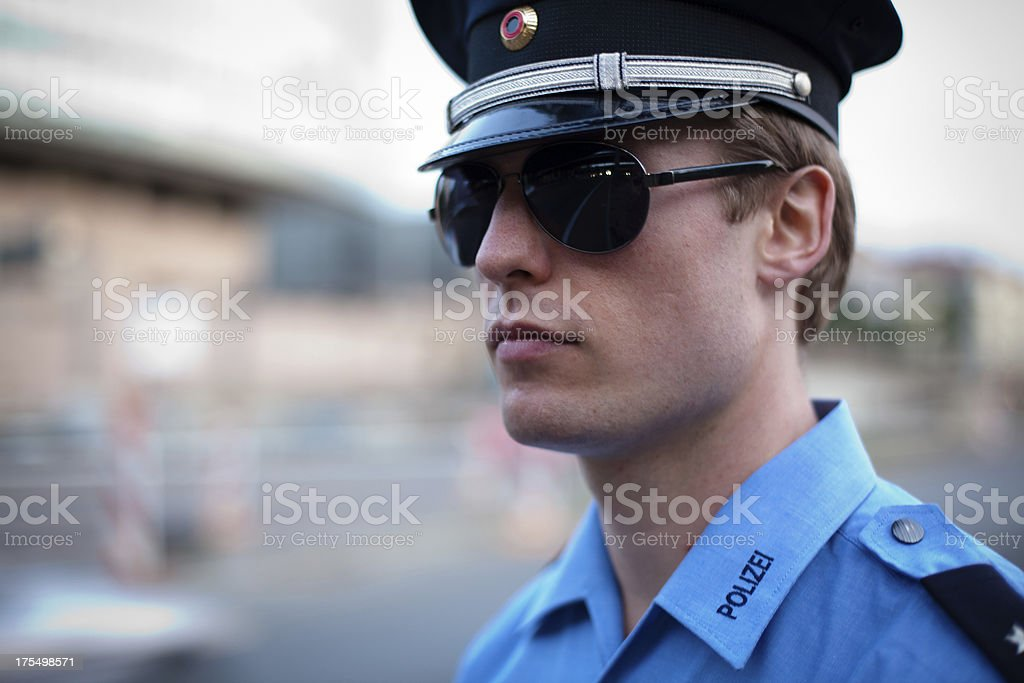 police officer in a blue uniform with sunglasses stock photo