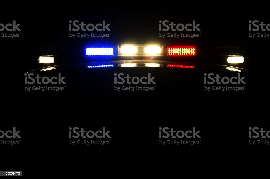 Police officer in car on night patrol stock photo