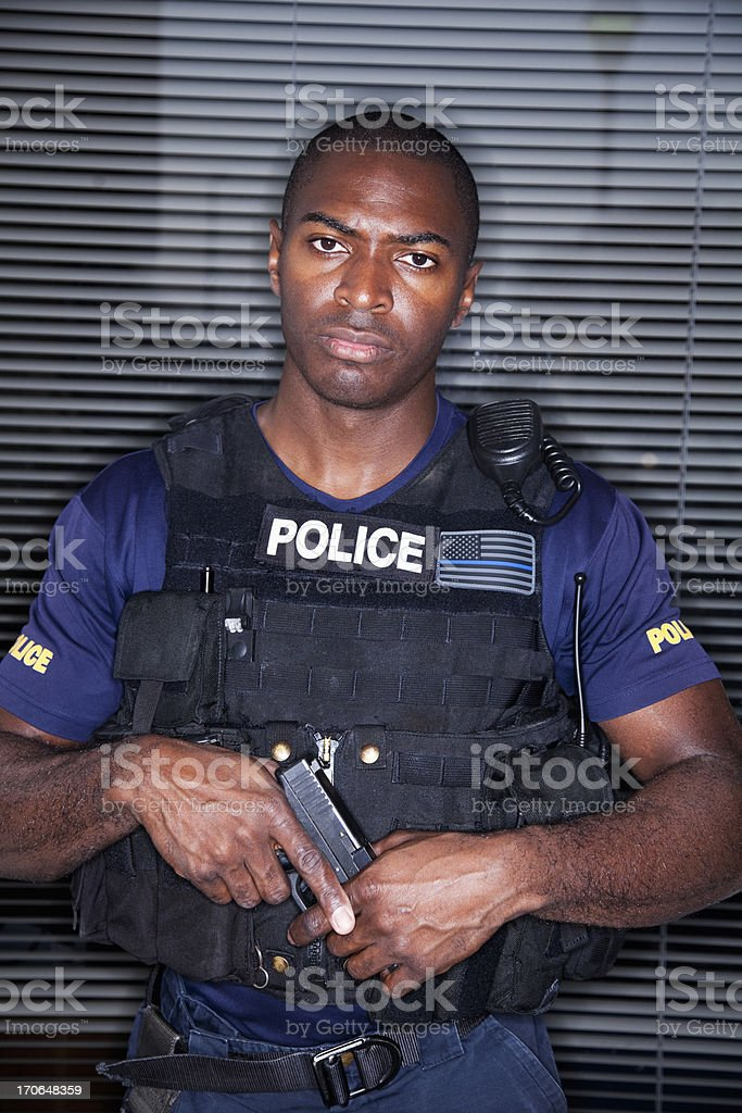 Police officer in tactical suit stock photo