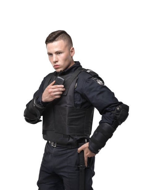Police officer in uniform on white background stock photo