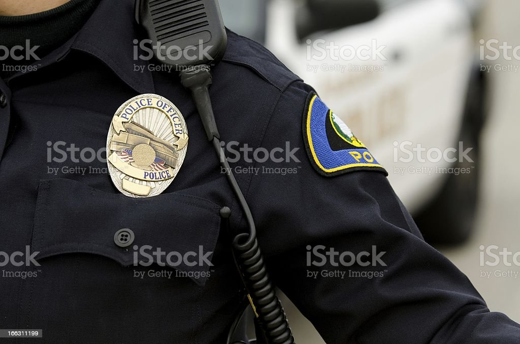 A police officer in uniform with a badge stock photo