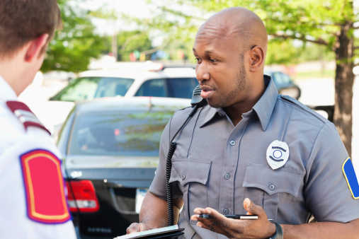 istock Police officer interogating people at an emergency scene 175416328