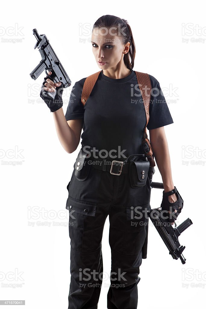 Police officer is holding 2 guns stock photo