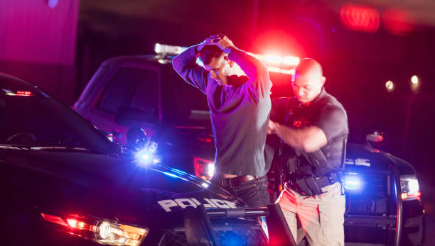 Police officer making an arrest stock photo