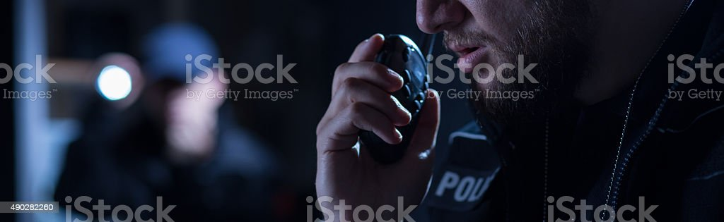 Police officer needs help stock photo