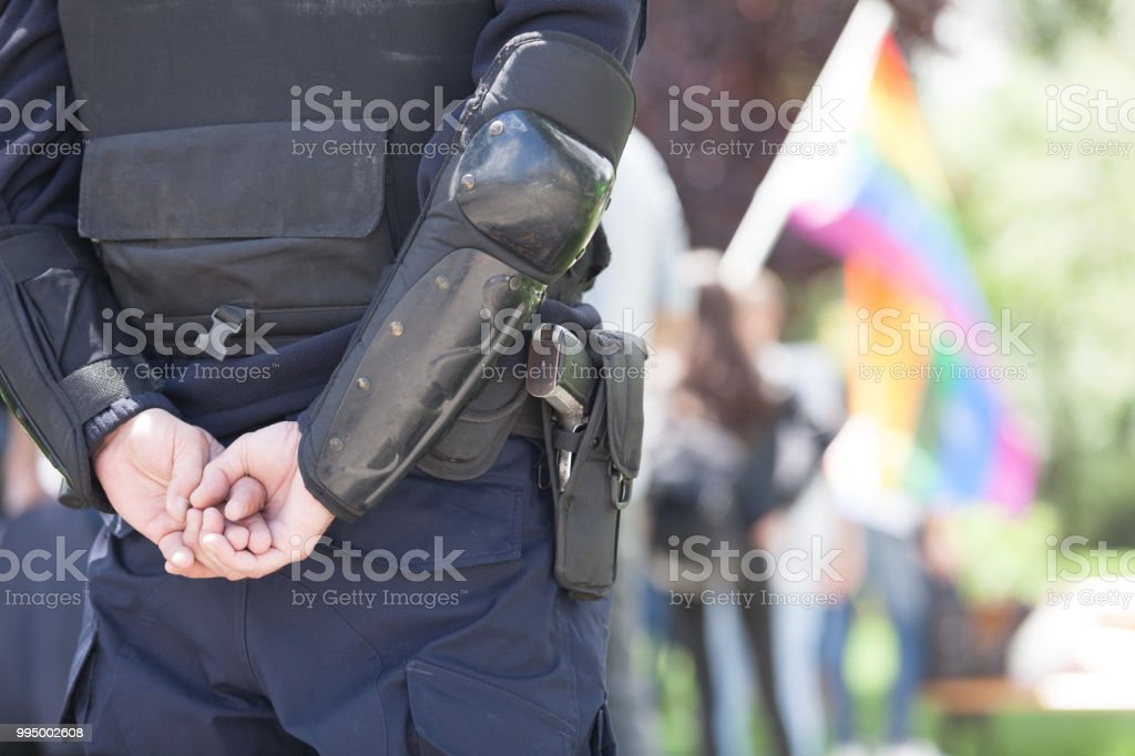 Police officer on duty during LGBT pride parade stock photo