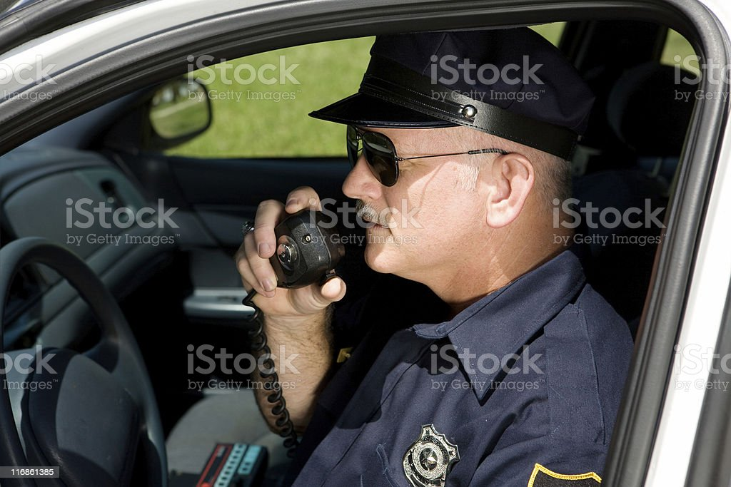 Police Officer on Radio stock photo