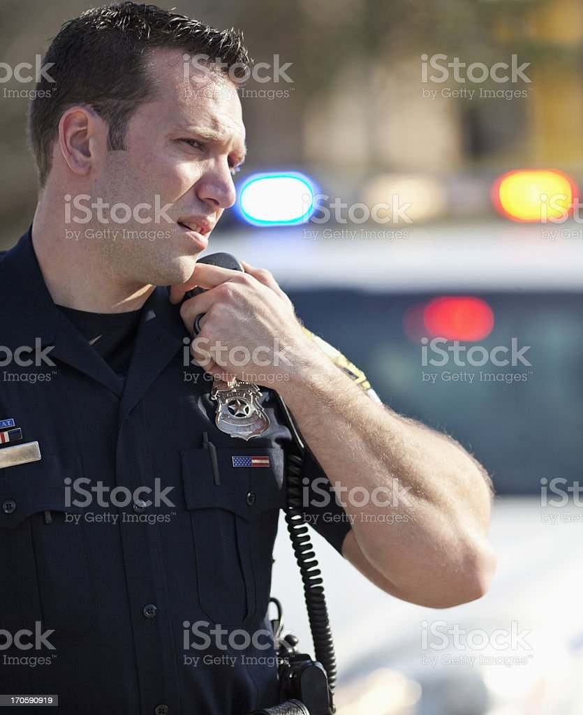 Police officer on radio royalty-free stock photo