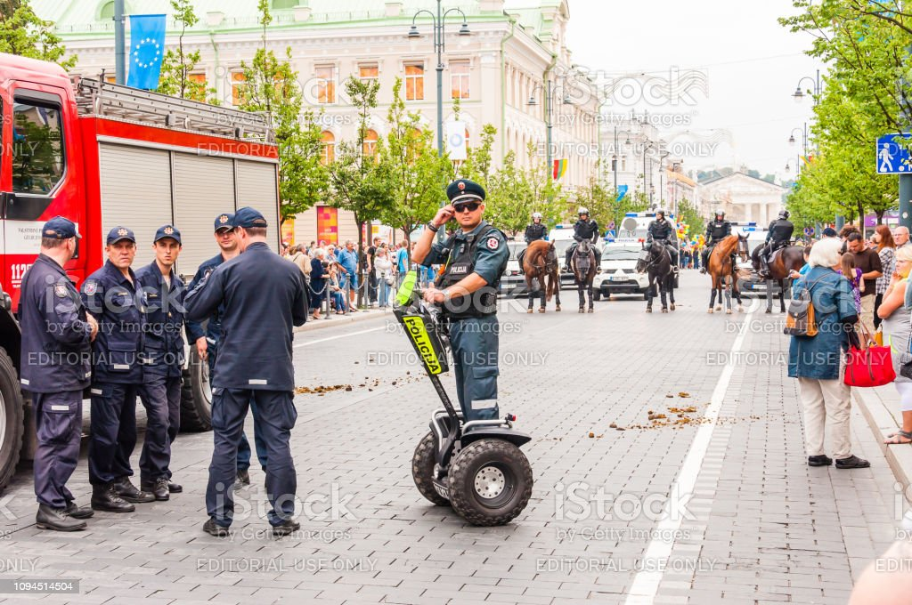 Police officer on Segway standing at the beginning of Pride parade on Gedimino street. Event celebrating lesbian, gay, bisexual, transgender, LGBTI culture pride stock photo