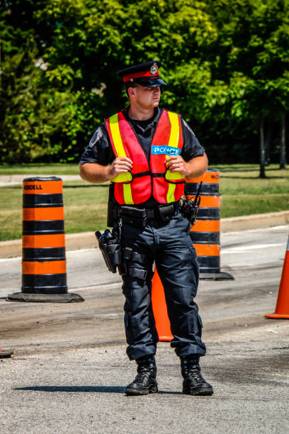 Police Officer on Traffic Duty wearing a high-visibility vest in Sarnia, Ontario, Canada stock photo