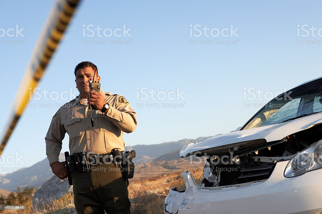 Police Officer on Walkie Talkie stock photo