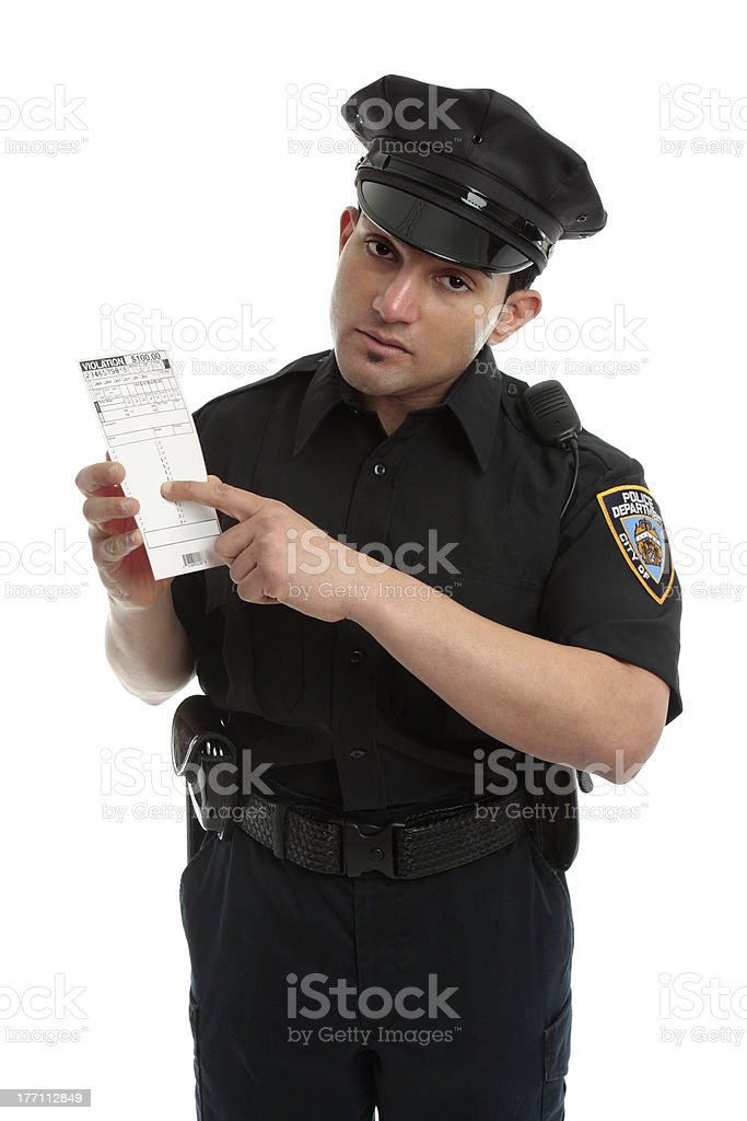 Police officer or traffic warden with infringement ticket royalty-free stock photo