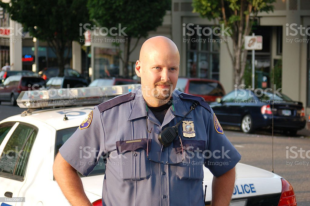 Police Officer Outside by Cars royalty-free stock photo