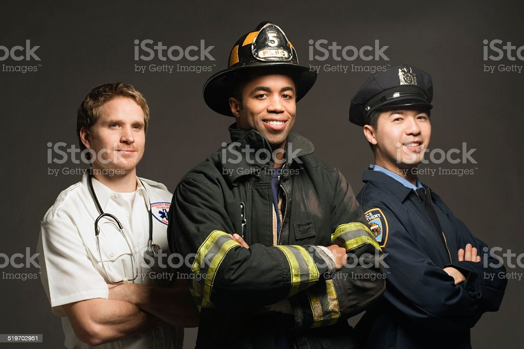 Police officer, paramedic and fireman, on black background, port stock photo