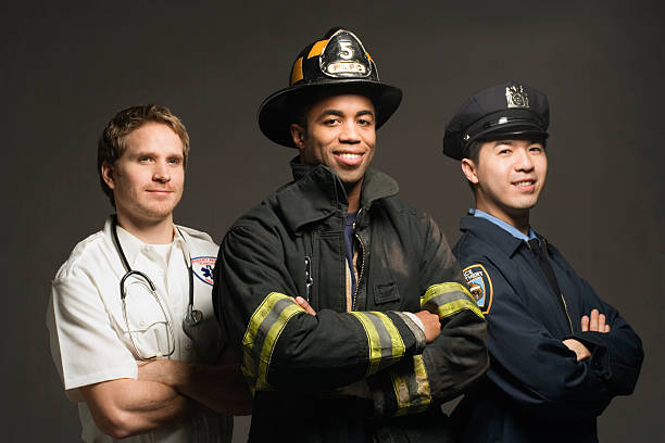 police officer, paramedic and fireman, on black background, port - firefighter stock photos and pictures