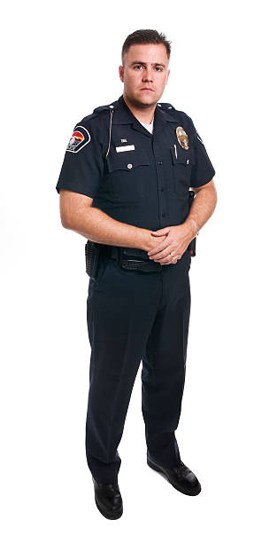 Police Officer  police uniform stock pictures, royalty-free photos & images