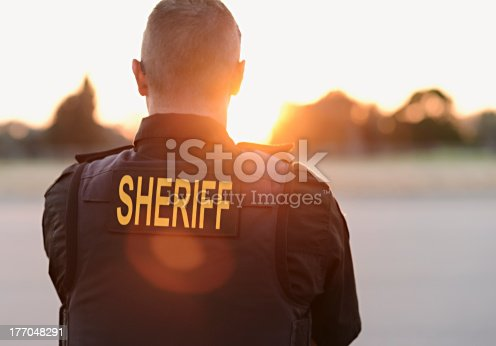 County Sheriff Police officer looks over the county while on duty.