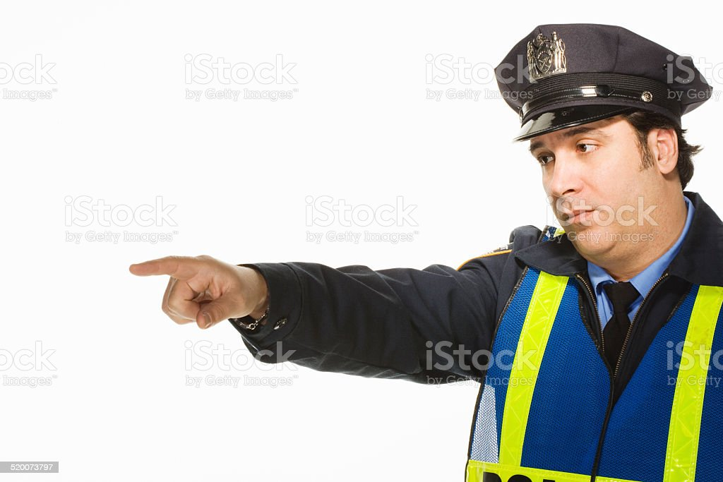 Police officer pointing on white background stock photo