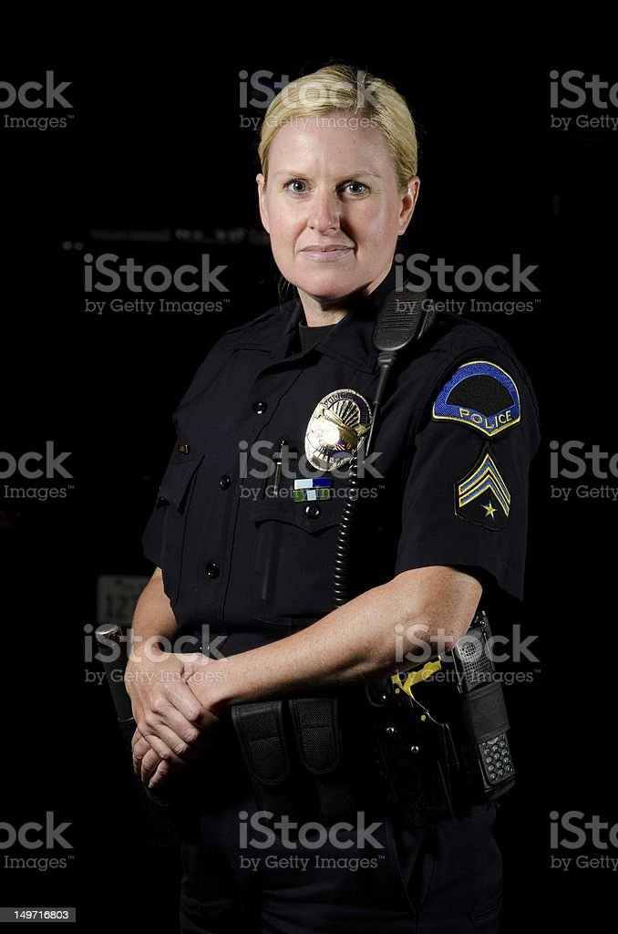 Police officer posing with a straight back & hands in front stock photo