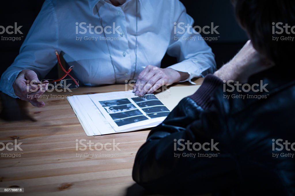 Police officer presenting evidence stock photo