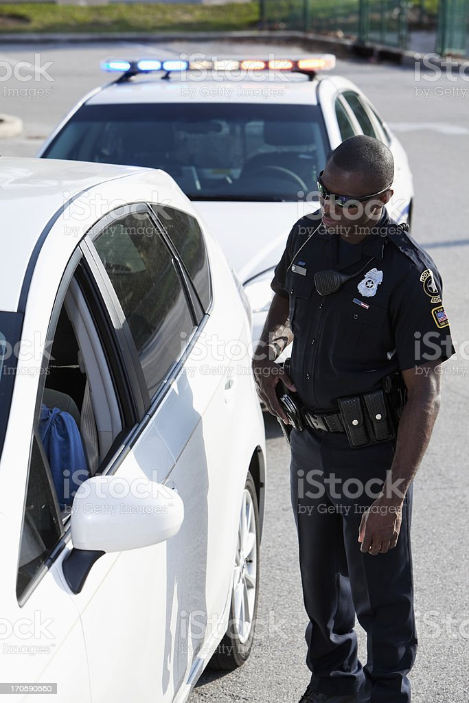 Police officer pulling over driver stock photo