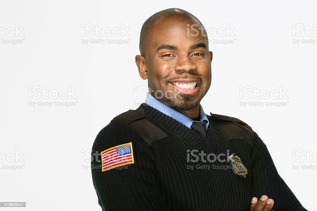 Police officer smiling, on white background, portrait stock photo