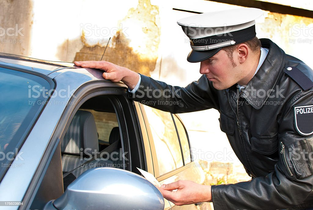 A police officer speaking to a driver at their window stock photo