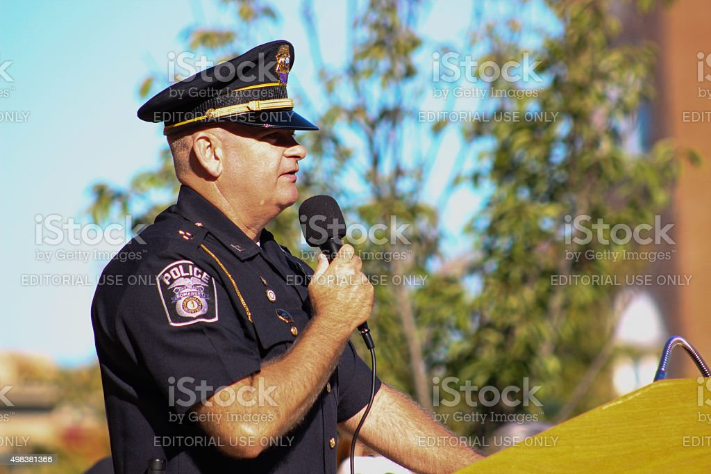 Police Officer Speaks into Microphone stock photo