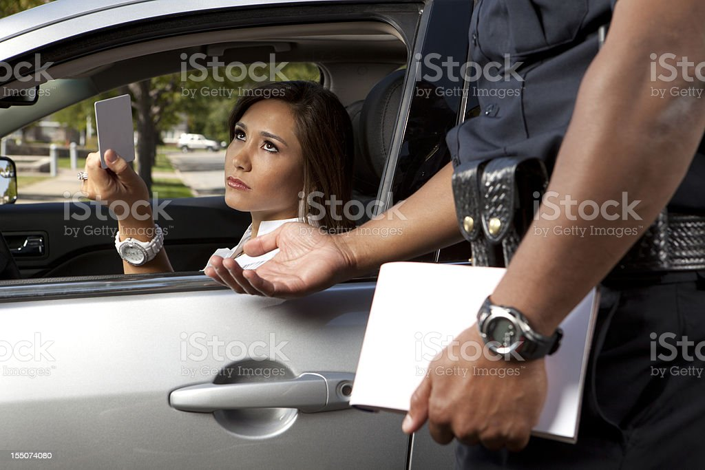 Police Officer taking driver's license stock photo