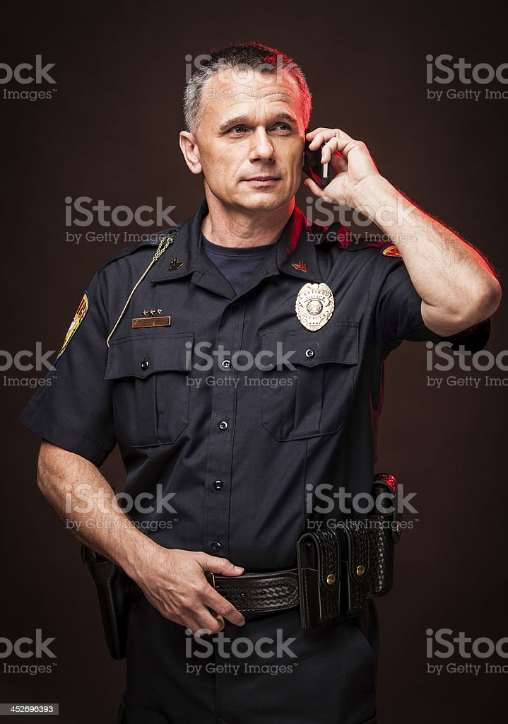 Police Officer Talking on Mobile Phone stock photo