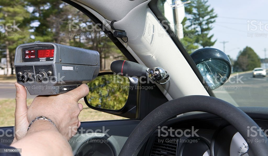 Police Officer Using a Handheld RADAR gun stock photo