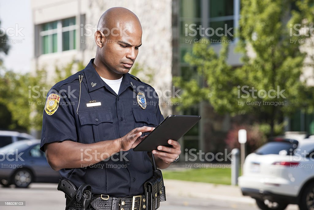Police Officer Using Computer Tablet stock photo